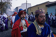 Holy Week. Good Friday, early morning procession departs from La Merced. The most spectacular Holy Week throughout Latin America, a sort of time machine to find an ancient Spain, where roman soldiers with the faces of Maya peasants interpret for days a choral rite alive in the collective memory as a matter of chronicle. In theatrical scenery of Antigua, between colonial palaces and Baroque churches uncovered by frequent earthquakes and eruptions of nearby volcanoes, processions come one after the other in an increasingly spasmodic crescendo until Holy Friday. From dawn to sunset for thousands of penitents, curucuchos rigorously dressed in purple, is a privilege, often passed down from father to son, to load on the shoulders heavy groups of statues with Jesus Christ, God, the Holy Spirit and the Virgin Mary.