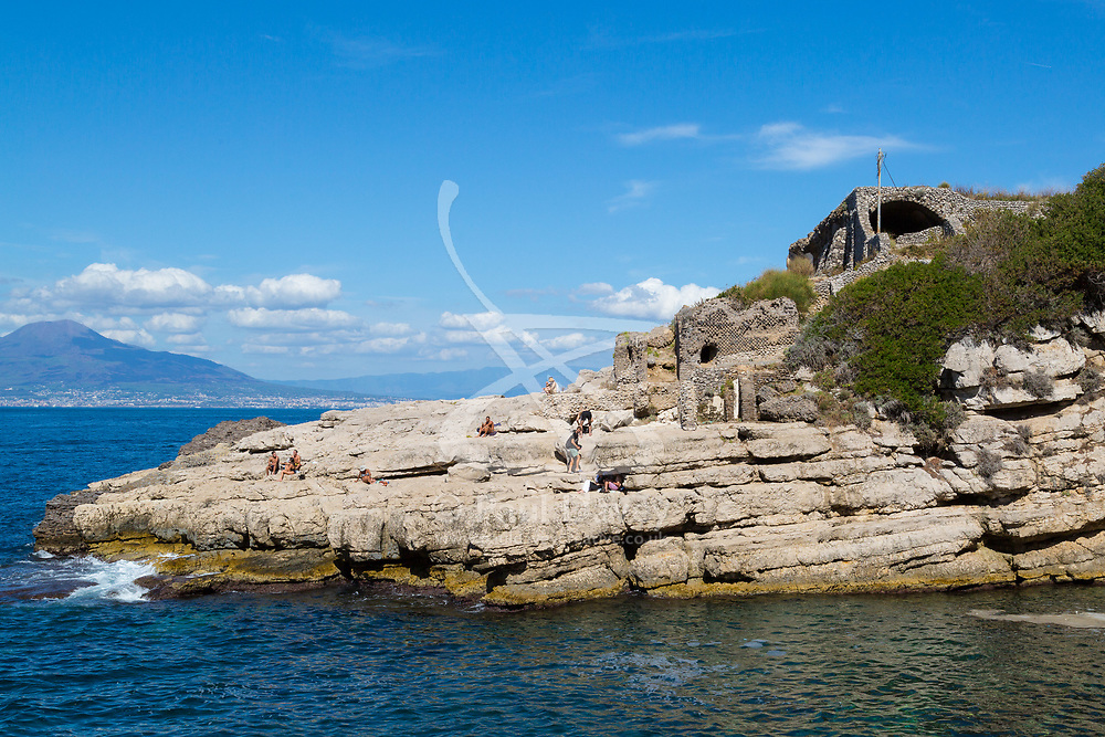 Sorrento, Italy, September 18 2017. Bathers enjoy the sunshine on il Capo by the ancient ruins of Villa di Polio Felice, near Sorrento, Italy. © Paul Davey