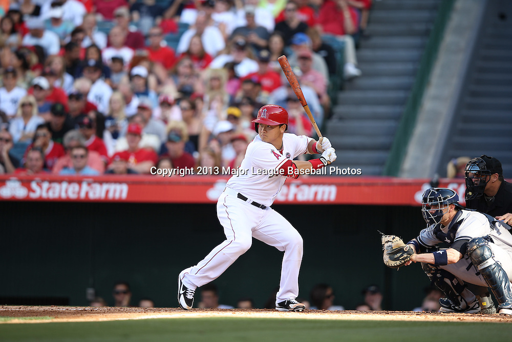 ANAHEIM, CA - JUNE 15:  Hank Conger #16 of the Los Angeles Angels of Anaheim bats during the game against the New York Yankees on Saturday, June 15, 2013 at Angel Stadium in Anaheim, California. The Angels won the game 6-2. (Photo by Paul Spinelli/MLB Photos via Getty Images) *** Local Caption *** Hank Conger