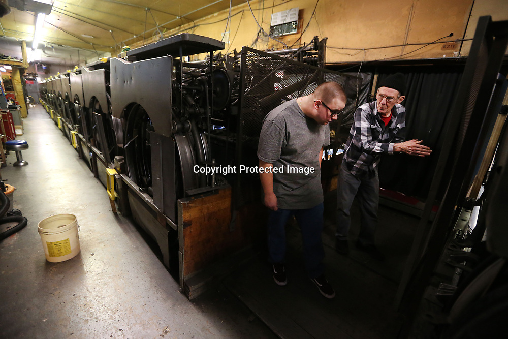 Morton talks with owner Matt Hartigan about one of the pinsetter machines. The Hartigan family bought Rebelanes in 1999, with the passing of Matt's father Kevin, in July, he joined his mother Lisa as an owner. Matt, 28, has been helping and working at Rebelanes since he was 10.