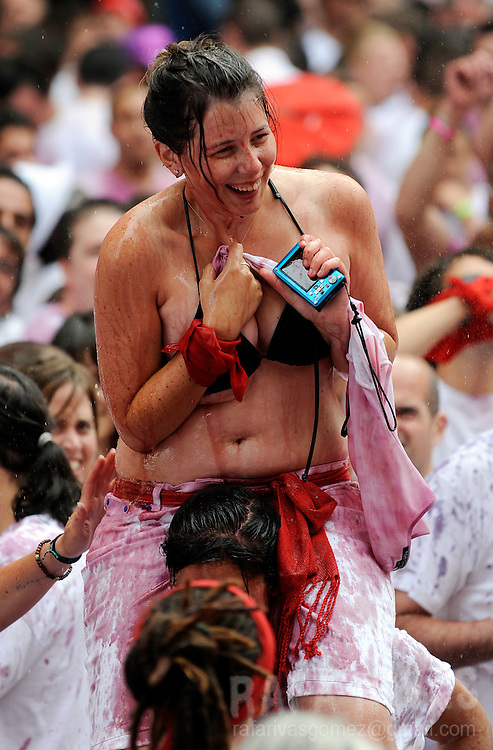 Participants take part in the 'Chupinazo' to mark the start at noon sharp of the San Fermin Festival on July 6, 2010 in front of the Town Hall of Pamplona, northern Spain. The festival is a symbol of Spanish culture, despite heavy condemnation from animal rights groups, and attracts thousands of tourists to watch the bull runs.  PHOTO/Rafa Rivas