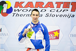 Haris Jahic of Slovenia celebrates after placed second during Kumite Individual male Seniors +84 kg at Day One of Karate 1 World Cup - Thermana Slovenia Lasko 2014 tournament, on March 15, 2014 in Arena Tri Lilije, Lasko, Slovenia.Photo by Vid Ponikvar / Sportida