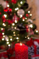United States, Washington, Bellevue, red candle and Chistmas holiday decorations (interior)