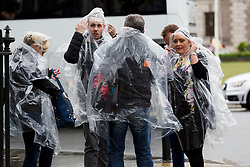© Licensed to London News Pictures. 14/05/2015. London, UK. Tourists in rain ponchos during heavy rain and wet and windy weather in Westminster, central London today. Photo credit : Vickie Flores/LNP