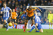 Wolverhampton Wanderers striker Benik Afobe (10) wins the ball during the Sky Bet Championship match between Brighton and Hove Albion and Wolverhampton Wanderers at the American Express Community Stadium, Brighton and Hove, England on 1 January 2016. Photo by Phil Duncan.
