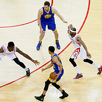 25 May 2015: Houston Rockets center Clint Capela (15) and Houston Rockets guard Corey Brewer (33) defend on Golden State Warriors guard Stephen Curry (30) during the Houston Rockets 128-115 victory over the Golden State Warriors, in game 4 of the Western Conference finals, at the Toyota Center, Houston, Texas, USA.