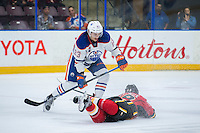 PENTICTON, CANADA - SEPTEMBER 17: Matt Benning #83 of Edmonton Oilers checks Matthew Tkachuk #19 of Calgary Flames to the ice on September 17, 2016 at the South Okanagan Event Centre in Penticton, British Columbia, Canada.  (Photo by Marissa Baecker/Shoot the Breeze)  *** Local Caption *** Matt Benning; Matthew Tkachuk;