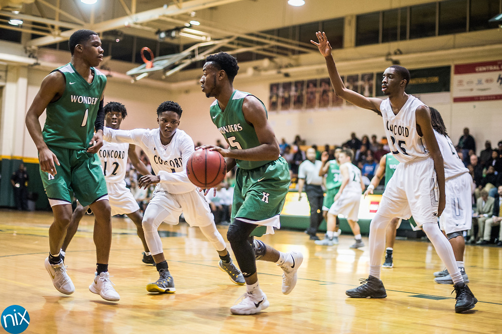 Kannapolis' Cordarius Butler (5) brings the ball out against Concord during a South Piedmont Conference basketball game Saturday night at Central Cabarrus High School.
