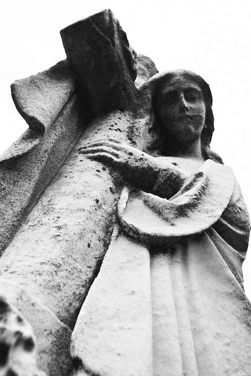 A angel carries her cross at the Congressional Cemetery.