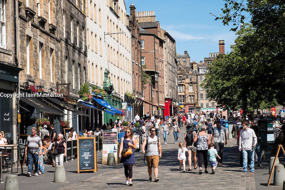 View along busy historic street in Grassmarket district of Edinburgh , Scotland, United Kingdom