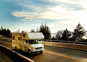 A motor home along the Sea to Sky Highway, with new retaining wall road widening.  Near Whistler BC, Canada.