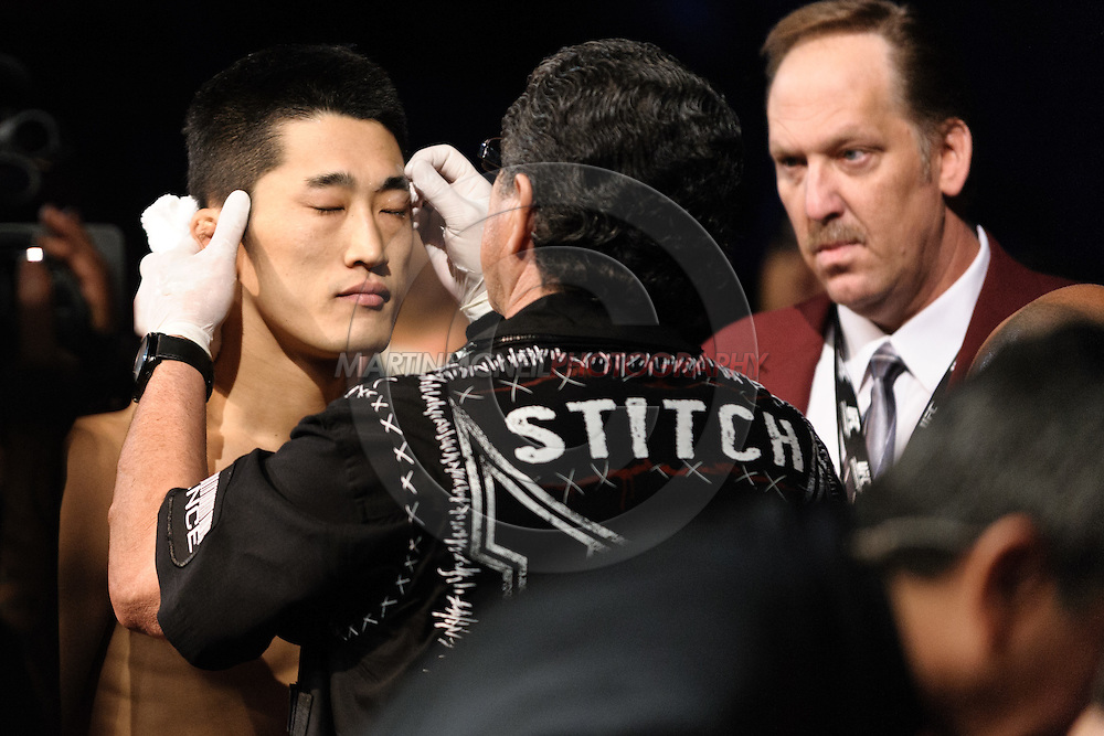 "LAS VEGAS, NEVADA. JULY 11, 2009: Dong Hyun Kim has vaseline applied by Jacob Duran before his fight at ""UFC 100: Making History"" inside the Mandalay Bay Events Center in Las Vegas, Nevada."