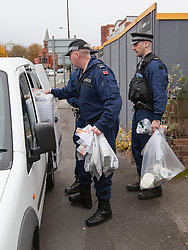 © Licensed to London News Pictures . 09/10/2012 . Altrincham , UK . Police remove discs and property from the house on 1 Woodlands Road , Altrincham , Cheshire today (9th October 2012) where they continue to search the premises . Police arrested Jimmy Savile's former chauffeur , Ray Teret , and housemate Alan Ledger , yesterday (8th November) over historic child rape allegations . Photo credit : Joel Goodman/LNP