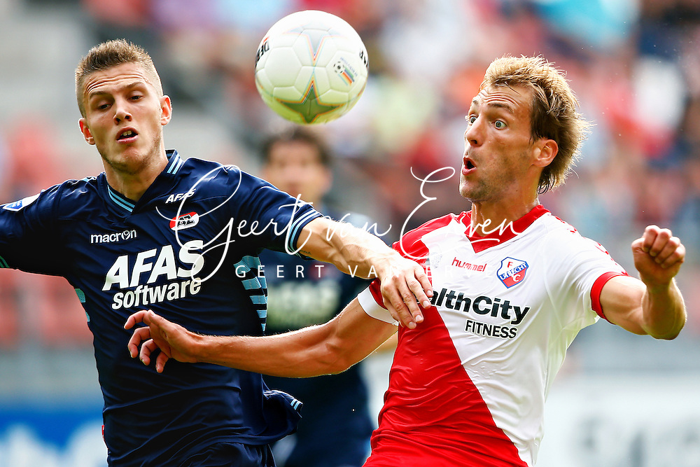 Onderwerp/Subject: FC Utrecht - AZ Alkmaar - Eredivisie<br /> Reklame:  <br /> Club/Team/Country: <br /> Seizoen/Season: 2013/2014<br /> FOTO/PHOTO: Willem JANSSEN (R) of FC Utrecht in duel with Jeffrey GOUWELEEUW (L) of AZ Alkmaar. (Photo by PICS UNITED)<br /> <br /> Trefwoorden/Keywords: <br /> #04 #17 $94 &plusmn;1371811811150<br /> Photo- &amp; Copyrights &copy; PICS UNITED <br /> P.O. Box 7164 - 5605 BE  EINDHOVEN (THE NETHERLANDS) <br /> Phone +31 (0)40 296 28 00 <br /> Fax +31 (0) 40 248 47 43 <br /> http://www.pics-united.com <br /> e-mail : sales@pics-united.com (If you would like to raise any issues regarding any aspects of products / service of PICS UNITED) or <br /> e-mail : sales@pics-united.com   <br /> <br /> ATTENTIE: <br /> Publicatie ook bij aanbieding door derden is slechts toegestaan na verkregen toestemming van Pics United. <br /> VOLLEDIGE NAAMSVERMELDING IS VERPLICHT! (&copy; PICS UNITED/Naam Fotograaf, zie veld 4 van de bestandsinfo 'credits') <br /> ATTENTION:  <br /> &copy; Pics United. Reproduction/publication of this photo by any parties is only permitted after authorisation is sought and obtained from  PICS UNITED- THE NETHERLANDS