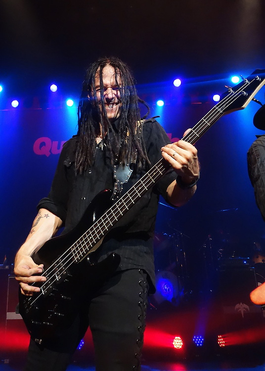 John Moyer of Disturbed performs with Geoff Tate's Queensryche at the Moore theater in Seattle, WA. during a 25th Anniversary performance of Operation Mindcrime. Photo by John Lill