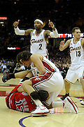 Apr 27, 2010; Cleveland, OH, USA; Cleveland Cavaliers guard Mo Williams (2) signals for a jump ball while Cleveland Cavaliers forward Anderson Varejao (17) and Chicago Bulls center Joakim Noah (13) battle for a loose ball during the fourth period in game five in the first round of the 2010 NBA playoffs at Quicken Loans Arena.  Mandatory Credit: Jason Miller-US PRESSWIRE