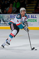 KELOWNA, CANADA -FEBRUARY 7: Madison Bowey #4 of the Kelowna Rockets skates with the puck against the Edmonton Oil Kings on February 7, 2014 at Prospera Place in Kelowna, British Columbia, Canada.   (Photo by Marissa Baecker/Getty Images)  *** Local Caption *** Madison Bowey;