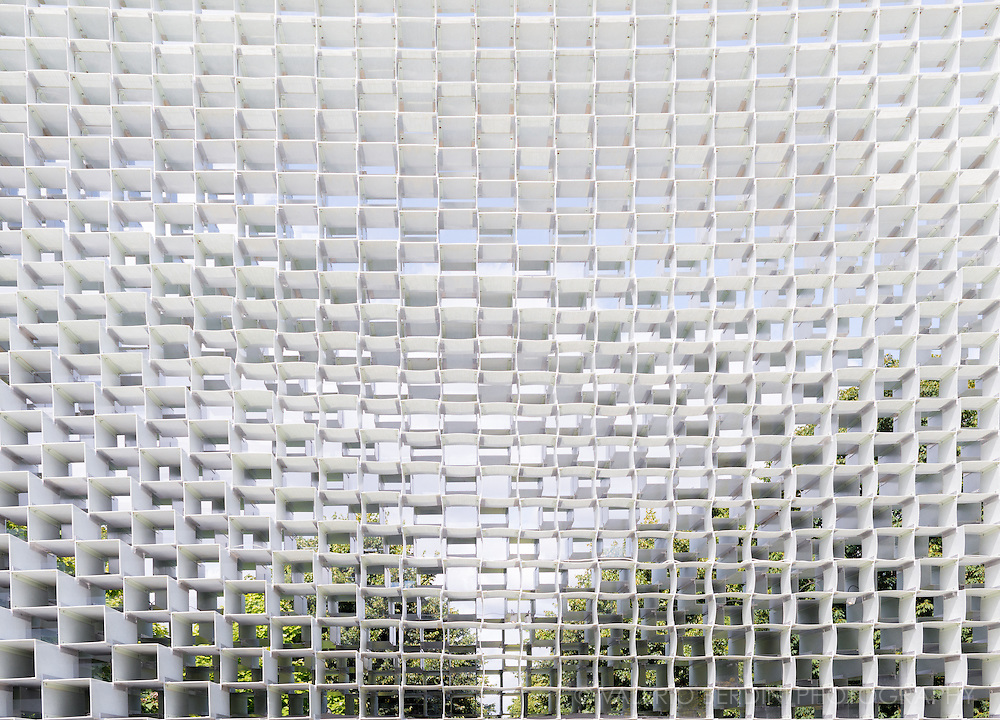 The Serpentine Pavilion, designed by Bjarke Ingels Group (BIG), is an &lsquo;unzipped wall&rsquo; that is transformed from straight line to three-dimensional space, creating a dramatic structure. For the Serpentine Pavilion 2016, we have attempted to design a structure that embodies multiple aspects that are often perceived as opposites: a structure that is free-form yet rigorous; modular yet sculptural; both transparent and opaque; both solid box and blob.<br /> We decided to work with one of the most basic elements of architecture: the brick wall. Rather than clay bricks or stone blocks, however, the wall is erected from pultruded fibreglass frames stacked on top of each other. (BIG)