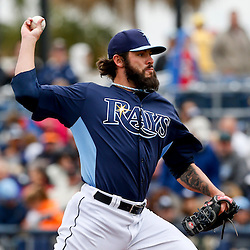 Mar 2, 2013; Port Charlotte, FL, USA; Tampa Bay Rays relief pitcher Josh Lueke (52) throws against the Baltimore Orioles during the top of the sixth inning of a spring training game at Charlotte Sports Park. Mandatory Credit: Derick E. Hingle-USA TODAY Sports