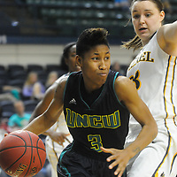 UNCW's Kelva Atkins drives on Drexel's Sarah Curran Sunday February 1, 2015 at Trask Coliseum on the campus of UNCW. (Jason A. Frizzelle)