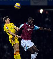 Photo: Alan Crowhurst.<br />West Ham v Liverpool. The Barclays Premiership. 30/01/07. Liverpool's Steven Gerrard (L) clears.