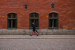 Pedestrian Walking in Stockholm's Old Town, Gamla Stan