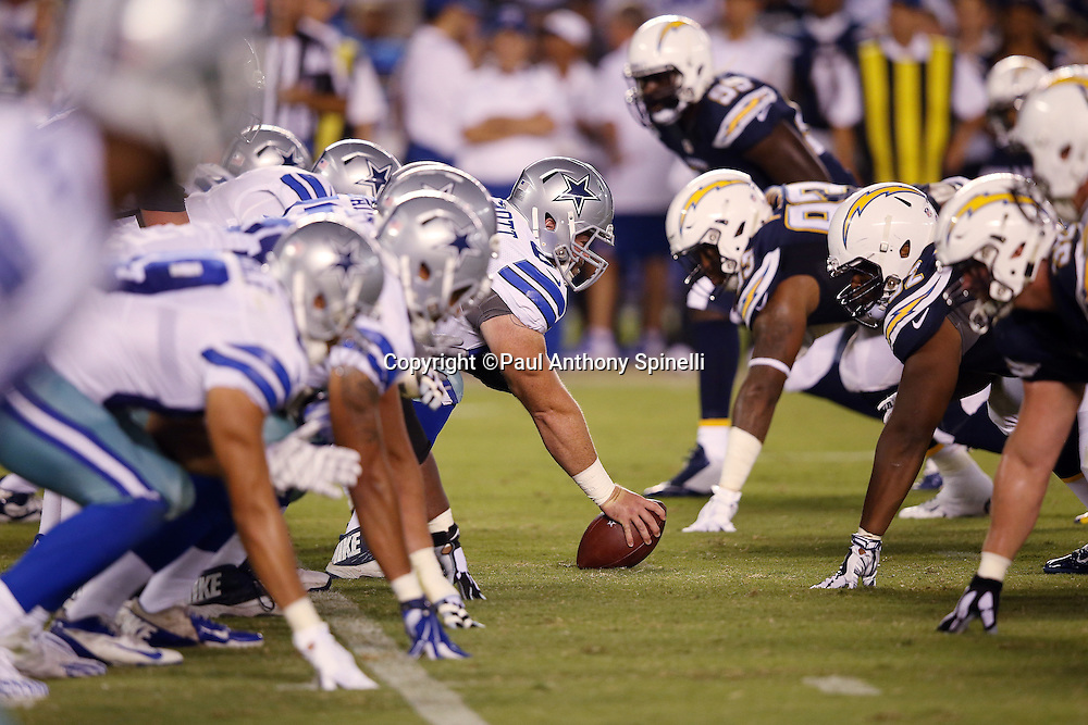 The Dallas Cowboys get set to snap the ball at the line of scrimmage during the 2015 NFL preseason football game against the San Diego Chargers on Thursday, Aug. 13, 2015 in San Diego. The Chargers won the game 17-7. (©Paul Anthony Spinelli)