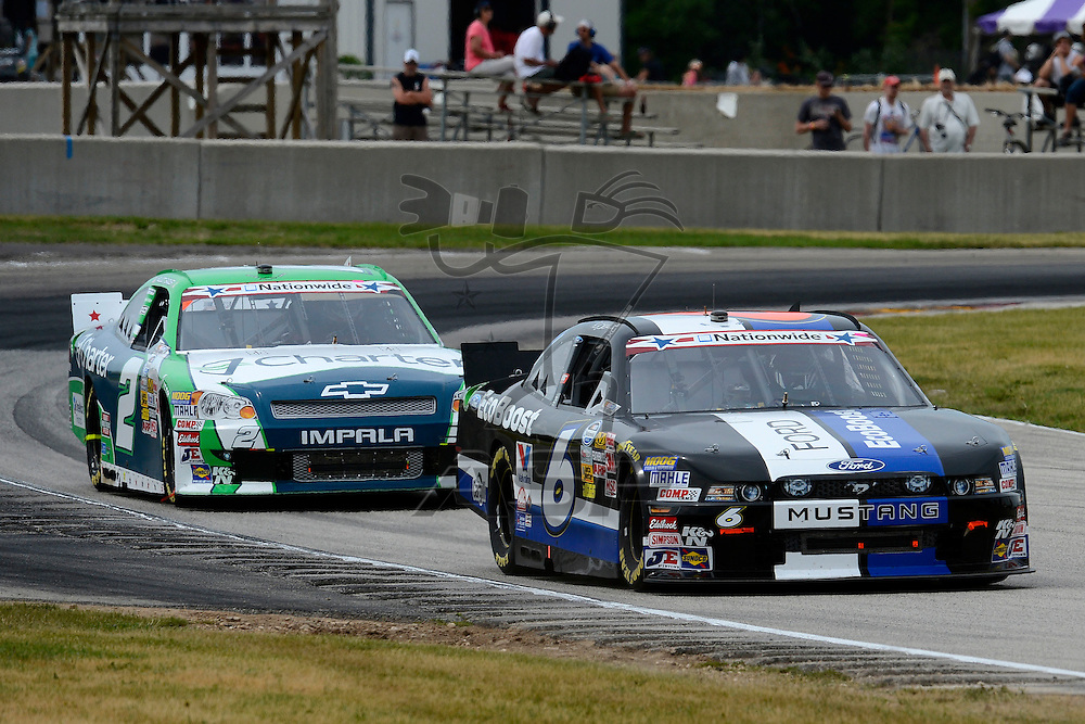 Elkhart Lake,WI - JUN 23, 2012: Ricky Stenhouse, Jr. (6) races during race action for the  Sargento 200  race at the Road of America in Elkhart Lake , WI.