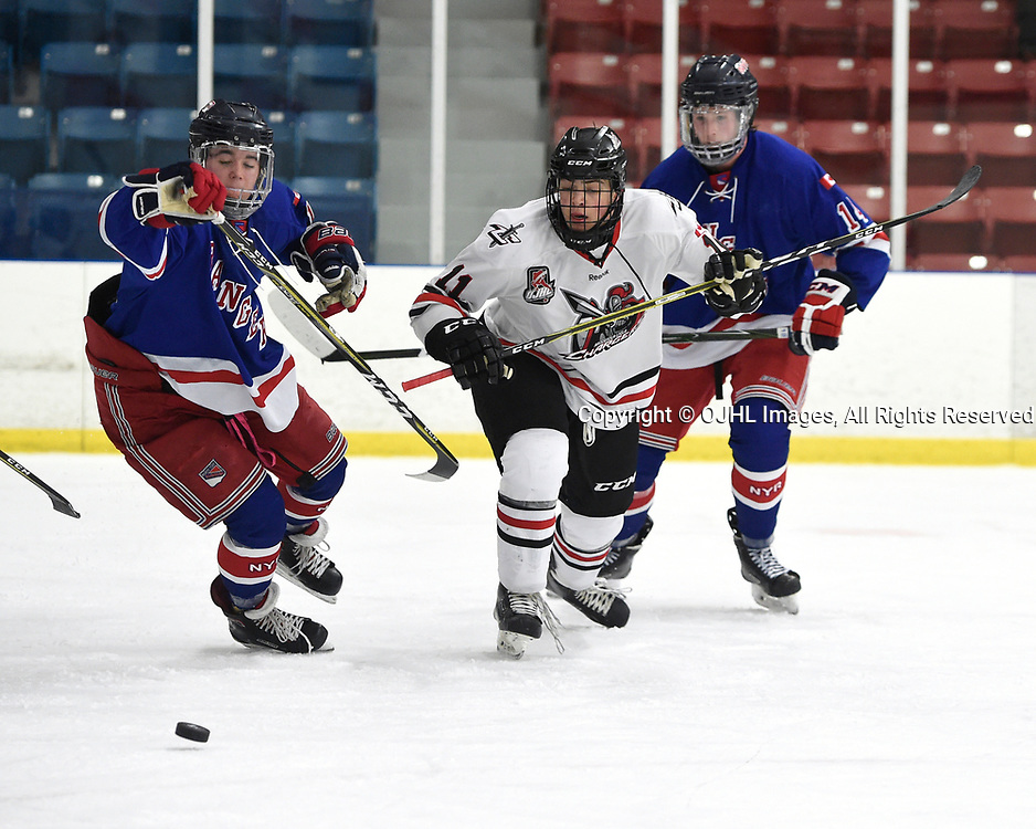 NORTH YORK, ON  - NOV 26,  2017: Ontario Junior Hockey League game between the North York Rangers and the Mississauga Chargers, Jesse Tucker #19 of the North York Rangers and Alex Daigle #11 of the Mississauga Chargers pursue the play during the second period.<br /> (Photo by Andy Corneau / OJHL Images)