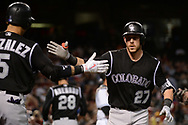 Apr 28, 2017; Phoenix, AZ, USA; Colorado Rockies infielder Trevor Story (27) is congratulated by teammate Carlos Gonzalez (5) after hitting a solo homer during the third inning against the Arizona Diamondbacks at Chase Field. Mandatory Credit: Jennifer Stewart-USA TODAY Sports