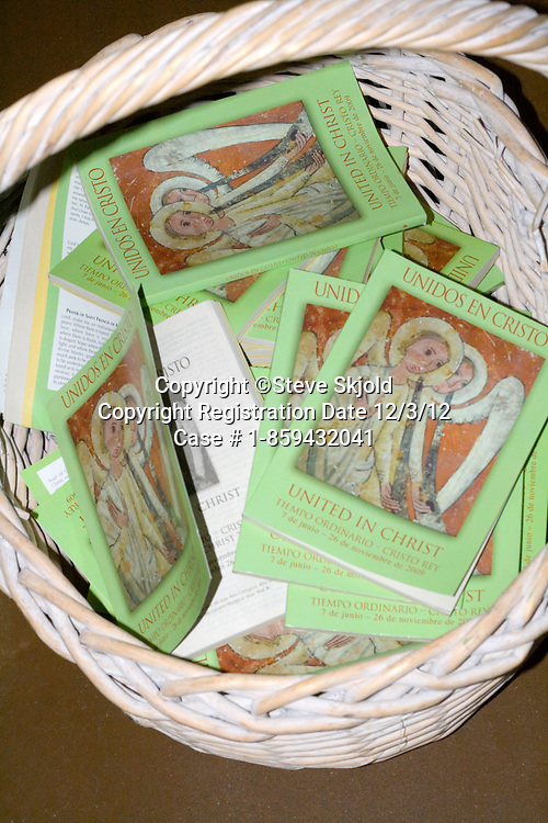 Basket of United In Christ pamphlets in the Catholic Church. Minneapolis Minnesota MN USA