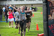 Steph Mussard celebrates as she runs to the finish line after finishing the Race for a Reason Mud Run. Photo by: Ross Brinkerhoff. Race for a Reason, Race 4 A Reason, Annual Events, Events, Students, Faculty & Staff