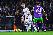 Adam Forshaw of Leeds United (4) looks up to pass the ball during the EFL Sky Bet Championship match between Leeds United and Bristol City at Elland Road, Leeds, England on 24 November 2018.
