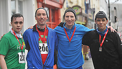 Gavin Whamsley, Paul Jennings, Noel McGourty and Martin Whamsley after the Streets of Westport 5K run on New Year's Day.<br /> Pic Conor McKeown