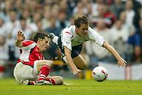 Photo: Aidan Ellis.<br />England v Austria. World Cup Qualifier. 08/10/2005.<br /><br />Michael Owen is sent flying by Austria's Paul Scharner.