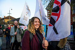 © Licensed to London News Pictures. 22/12/2016. London, UK. Heathrow rotestor SOPHIA LYSACZANKO (pictured front) arrives at Ealing Magistrates Court in London. 15 protestors are charged with Wilful Obstruction of the Highway after blocking an access road to Heathrow on November 18, 2016. Photo credit: Ben Cawthra/LNP