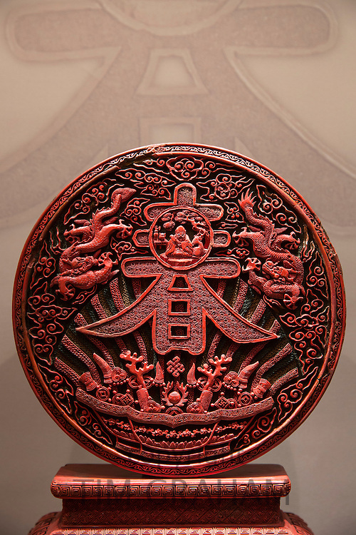 Chinese Beijing red lacquer ritual disk object 17th to 19th Century in Manos Collection, Museum of Asian Art in Kerkyra, Corfu