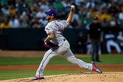 OAKLAND, CA - SEPTEMBER 21:  Jonathan Hernandez #72 of the Texas Rangers pitches against the Oakland Athletics during the second inning at the RingCentral Coliseum on September 21, 2019 in Oakland, California. The Oakland Athletics defeated the Texas Rangers 12-3. (Photo by Jason O. Watson/Getty Images) *** Local Caption *** Jonathan Hernandez