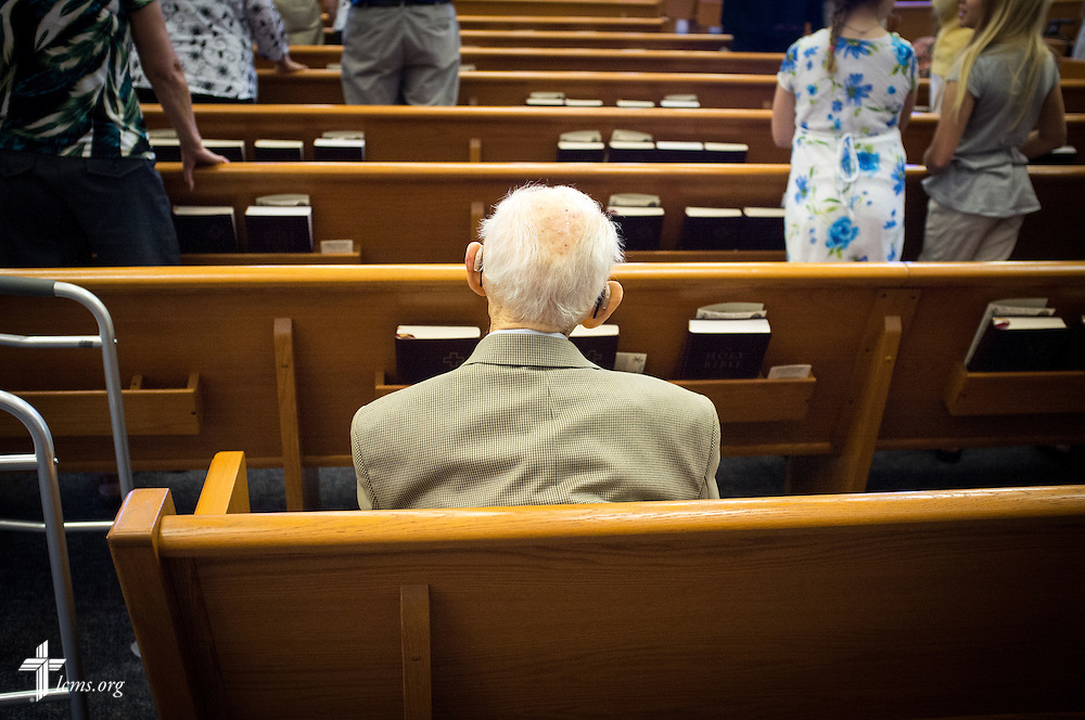 An elderly man rests in a pew during worship Sunday, July 27, 2014, at Christ Lutheran Church in Normal, Ill. LCMS Communications/Erik M. Lunsford