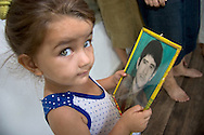 Aga Agalarov, a soldier in the Azerbaijani army, has been missing since 1993, his fate unknown.  Here, his niece holds a picture of him at his family's house near Zardab, Azerbaijan.