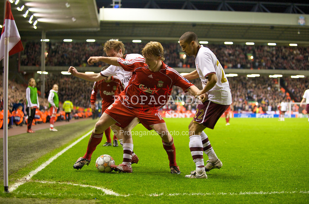 LIVERPOOL, ENGLAND - Tuesday, April 8, 2008: Liverpool's Dirk Kuyt sheilds the ball from Arsenal's Aleksandr Hleb and Gael Clichy during the UEFA Champions League Quarter-Final 2nd Leg match at Anfield. (Photo by David Rawcliffe/Propaganda)