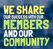 We Share Our Success With Our Members and Our Community, East of England Co-operative Society shop advertising boards hoardings, Woodbridge, Suffolk, UK