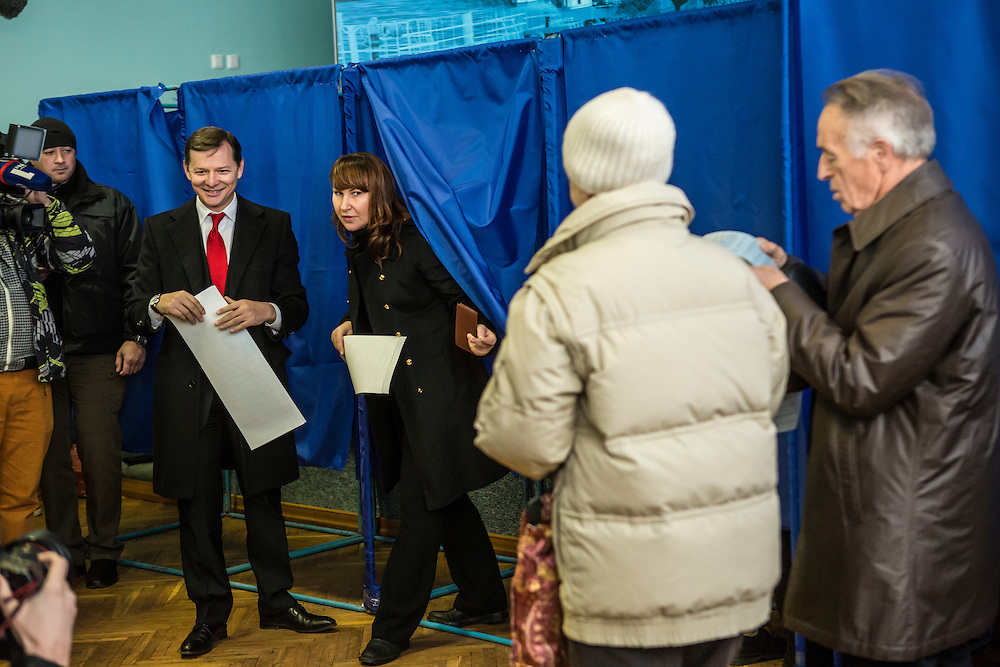 KIEV, UKRAINE - OCTOBER 26: Oleh Lyashko, head of Ukraine's Radical Party, and his wife Rosita Sayranen emerge from voting booths after filling out their ballots at a polling station on October 26, 2014 in Kiev, Ukraine. The country's parliamentary elections are seen as key to President Petro Poroshenko's ability to advance his agenda. (Photo by Brendan Hoffman/Getty Images) *** Local Caption *** Oleh Lyashko;Rosita Sayranen