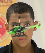 Students at the Harris County Department of Education Academic and Behavioral School West compete flying remote helicopters on an obstacle course.