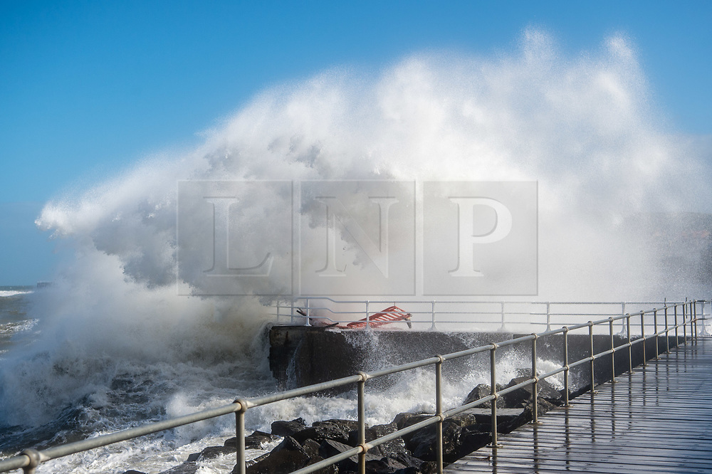 Aberystwyth Wales UK, Thursday 14June 2018<br /> <br /> UK Weather:  Storm Hector, with winds reaching 60 or 70mph in parts of the north of the UK, brings huge waves crashing into the sea defences in Aberystwyth on the coast of west wales at high tide this morning