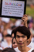 "12 JANUARY 2014 - BANGKOK, THAILAND: A pro-democracy advocate at Thammasat University. About 500 people from all walks of Thai life came to a candlelight vigil at Thammasat University. They prayed for a peaceful resolution to the political conflict in Thailand. They finished the vigil by singing the John Lennon song ""Imagine."" Anti-government protestors are expected ""Shutdown Bangkok"" Monday. There were reports Sunday evening that some intersections were already being blocked.       PHOTO BY JACK KURTZ"