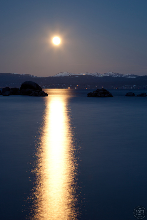 """""""Full Moon Setting Over Tahoe 2"""" - Photograph shot from Sand Harbor of a full moon setting in the early morning over Lake Tahoe, Nevada."""