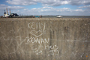 Teenage love graffiti has been written in chalk on the Thames flood wall located on the Saxon Shore Way at Gravesend