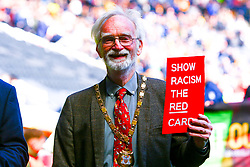Milton Keynes mayor Martin Petchey holds up a 'Show racism the red card' sign up during a march around the pitch at Stadium MK ahead of the final league game of the season for MK Dons - Mandatory by-line: Ryan Crockett/JMP - 04/05/2019 - FOOTBALL - Stadium MK - Milton Keynes, England - Milton Keynes Dons v Mansfield Town - Sky Bet League One