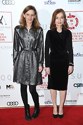 Mia Hansen-Love and Isabelle Huppert arriving at the London Film Critics Circle Awards 2017, the May Fair Hotel, London.
